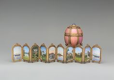 Danish Palaces Egg by the House of Carl Fabergé, presented by Alexander III to his wife Maria Feodorovna in 1890. Green, rose, and quatre-couleur gold, guilloche' enamel, star sapphire, cabochon emerald, rose-cut diamond nacre, crystal crimson silk velvet. The surprise is a screen with 10 miniature paintings of Danish and Russian palaces and 2 imperial yachts; Workmaster: Mikhail  Perkhin; Artist: Miniatures by Konstantin Krijitski (died 1911); 4 x 2 5/8 x 2 5/8 in. (10.2 x 6.7 x 6.7 cm).