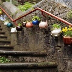 A beautiful way to reuse old teapots! Create unique garden decor and plant holders.