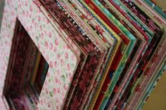 Recycle cereal boxes into darling fabric-covered mats for picture frames. So sweet!