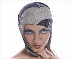 Poly Animaux Helmet with extra long earflaps by Jasmin Zorlu                 Black and white leather patchwork of Nile Perchskin, Stingray, Lizard, Snake, Crocodile, and Alligator Leather     photo by Rudi Amedeus