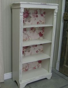shabby a plain bookcase with wallpaper and details