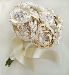 Ivory and Cream Silk Catala and Jeweled Bloom Bridal Bouquet. $900.00, via Etsy.