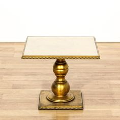 This end table is featured in a solid wood with a shiny gilt finish. This European style side table has a baluster pedestal base, roped edges, and faux marble top. An elegant piece that's perfect for the living room! #european #tables #endtable #sandiegovintage #vintagefurniture