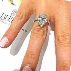 OMG! This is my dream ring, definitely no bigger than this.. I think I'd be content with a 1.5-1.6 carat pear diamond… and of course the halo.