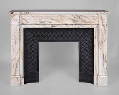 Beautiful antique Louis XVI style fireplace in Paonazzo marble with vitruvian scroll frieze