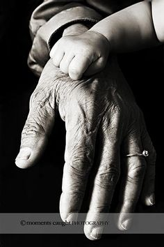 grandmother and grand daughters hands