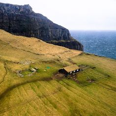 Chris Burkard | Grass-roof home alongside a small Viking graveyard on the edge of nowhere in the Faroe Islands