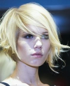 Asymmetrical bob. Super cute! Def want to try this hairstyle soon.