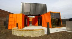 Orange and black shipping container office.