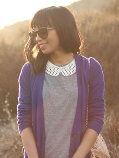 wear a bib necklace over a high t-shirt so that is almost looks like a part of your top.