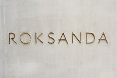 Roksanda Gold Signage on Concrete