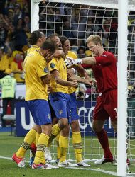 Swedish players celebrate their second goal in front of England goalkeeper Joe Hart during the Euro 2012 soccer championship Group D match between Sweden and England in Kiev, Ukraine, Friday, June 15, 2012. (AP Photo/Sergei Grits)