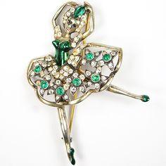 An Eisenberg Sterling Gold Metallic Enamel and Emeralds Ballerina Brooch.