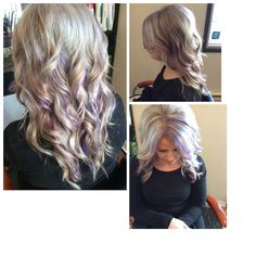 Messy ash blonde curls with some purple peek a boos