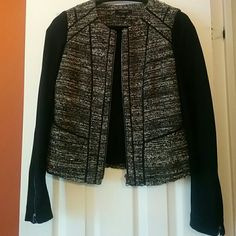 """Ann Taylor Jacket NWOT Ann Taylor jacket size 0 worn ones. Shell body made of 37% acrylic 31% wool 23% nylon 9% Cotton. Sleeve 71% rayon 23% nylon 5% spandex. Lining 94% polyester 6% spandex. it has two simple pockets, no zippers no buttons . 4"""" deep and 4.5"""" wide.  Sophisticated jackets top of any outfits (and occasion) with a collarless cut, corded trim on packets and on front and back of jacket. Closes with zipper. Both Sleeves has little zippers. Sleeves are 24"""" long Ann Taylor Jackets…"""