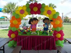 baloon party background ideas | Dora and Diego cake table decoration with flowers balloon arch