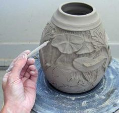 Carving low-relief surface designs into wet clay.  This is adaptable to metal clays.