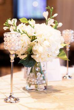 Photographer: Katie Lewis Photography; Elegantly simple white flower wedding reception centerpiece