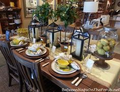 "This table had a ""lemon"" theme with lemon dishware. The black lanterns in the centerpiece look great with the yellow in the dishware. -"