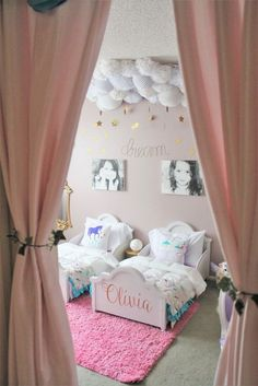 This shared big girl room for sisters is seriously dreamy. Love the cloud and stars decor!: