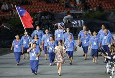 Samoa's flag bearer Opeloge holds the national flag as he leads the contingent in the athletes parade during the opening ceremony of the London 2012 Olympic Games at the Olympic Stadium in London England