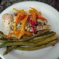 Baked Chicken Breast spiced with Mrs. Dash Garlic and Herbs, Sea Salt, Pepper, and Lemon Juice.  Topped with all variety color bell pepper, red onion, and asparagus.  Baked at 350 for 15 to 30 minutes.