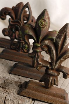 """Mounted Keys Set of Two $20    These are distressed heavy cast iron fleur de lis. Finished in an assortment of colors with an antique wash.    Beautiful cast iron Fleur de Lis set  . Each is different. Dark rust brown finish  Range in size from 5-3/4"""" to 5""""   Bases measure 3-3/4"""" x 2"""""""