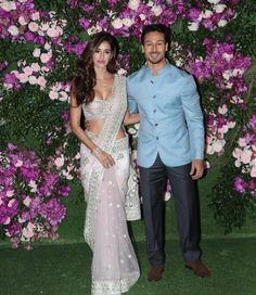 Disha Patani looked glamorous in this blush pink saree and Tiger Shroff looked dapper in a blue bandgala! Bollywood Couples, Indian Bollywood, Bollywood Stars, Bollywood Fashion, Bollywood Wedding, Bollywood Girls, Famous Celebrities, Bollywood Celebrities, Bollywood Actress