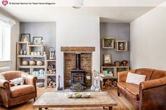Escape to the Country home of Sarah Wilkie founder of Homebarn. Photographed by Michael Norman 35 Cheap Traditional Decor Style To Work on Today – Escape to the Country home of Sarah Wilkie founder of Homebarn. Photographed by Michael Norman Source Cottage Living Rooms, New Living Room, Home And Living, Living Room Ideas Tan Sofa, Cozy Living, Cream Leather Sofa Living Room, Living In The Country, Living Room With Stove, Living Room Brick Wall