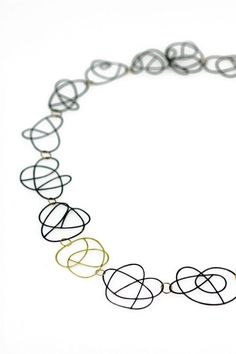 Christine Kaltoft: flock necklace in oxidised silver and 18ct gold