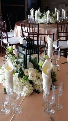 Gorgeous and simple centerpieces with hydrangeas, spray roses, tulips, stock and lily grass. IKEA lanterns and candles. This all white centerpiece is great for weddings, communions, baptism, 50th Wedding Anniversary, engagement and galas. Design by Diana Culver, CBA and CCF. San Diego, CA.