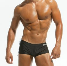 Classic brief - trunk by Modus Vivendi in black. This brazil cut swimwear is made from a fast drying, high quality material that sits snug to the body, offering comfort and great style. Covered waist with inside drawstrings ending in metal tips for a custom fit. Ideally shaped and manufactured to perfection, this design features a straight cut lined front and a discreet Modus Vivendi logo to the side. Classic style never goes out of fashion!