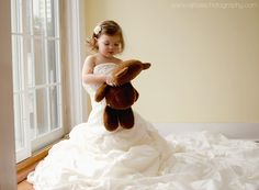 Toddler Girl in Mom's Wedding Dress. www.facebook.com/ejrosephoto: Morris County Newborn and Child photographer.