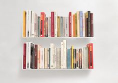 "The set of 2 Bookshelf ""U"" is simple and functional way to store your book collection. Characteristics for each shelf : 5,9 inch deep, 5,9 inch high, 23,62 inch long, weight 7 pounds. Made of 0,07 inch-thick steel Each shelf can holds up to 44 pounds The 2 shelves offer 47,24 of usable length !"