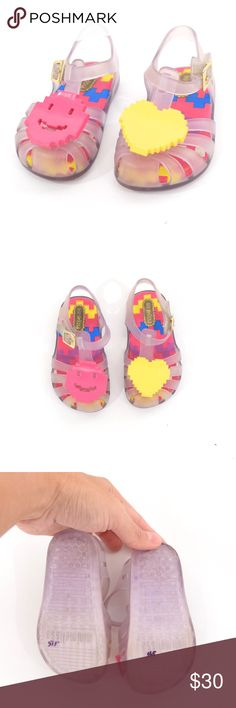 Mini Melissa Digital Jellies Super cute little girl's sandals from my favorite footwear brand, Mini Melissa. Jelly style, with a clear body and bright yellow smiley face on one toe and pink heart on the other. Very light wear. Toddler girl's size 6, my child has worn Mini Melissa's since she could walk and I think they run a little big. Mini Melissa Shoes Sandals & Flip Flops