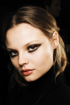 A new spin on eyeliner: Disconnected from each other and thick gives a sleek and powerful look.