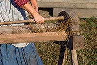 The first step in flax processing is to separate the straw from the fiber.