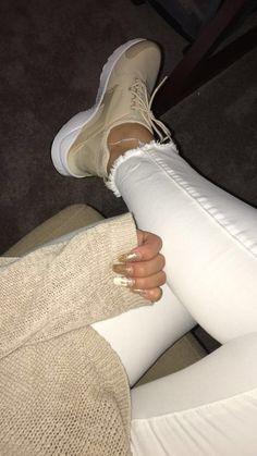Tan womans nike air huraches ultras, white jeans, gold nails