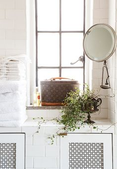 Tile built-in hides radiator & adds storage, trophy doubles as a planter, & metal scale works as a jewelry catchall.