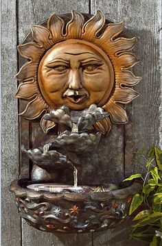 sun face wall water feature...I want this for my collection!