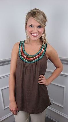 Colorful beading and gold sequins spice up a basic brown tank in the cutest of ways! The splash of color and loose fit combine to give it a cool bohemian feel that looks fabulous with neutral shorts or pants. The outer layer is a gauze-like fabric and the liner is 100% cotton.     Fits a bit roomy. Stacy is wearing size XSmall.