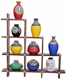 Terracotta Pots on Wooden Shelves