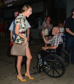 Taylor Swift chats with a man on the street in NY