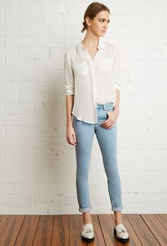 Mid rise skinny ankle jeans featuring a cuffed hem, zip fly, and classic five-pocket construction.