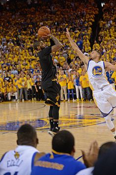 Kyrie Irving of the Cleveland Cavaliers shoots a three point basket to win the game against the Golden State Warriors during the 2016 NBA Finals Game. Kyrie Irving Celtics, Irving Nba, Irving Wallpapers, Nba Wallpapers, Iphone Wallpaper Kyrie Irving, 2017 Nba Finals, Nba Finals Game, Basketball Is Life, Basketball Players