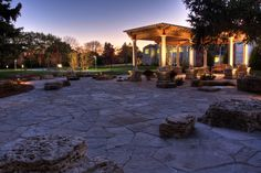 Limestone patio with scribed seating boulders using Eden irregular flagstone.