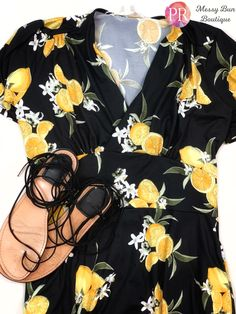 How cute is this black lemon dress?  Grab your Paisley Raye Dahlia in the boutique now!