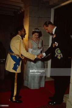 Emperor Haile Selassie shaking hands with Prince Philip while Queen Elizabeth II is standing next to them in the Menelik palace in Addis Ababa during her visit to Ethiopia in February of 1965.