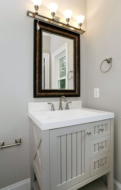 Keep small bathroom spaces simple with light colors and clean lines. A vanity with lots of storage helps keep the space clutter-free.