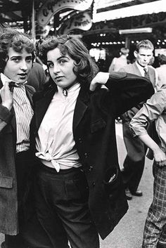 Teddy Girls, Battersea Funfair, London 1956, taken by street photographer Roger Mayne.